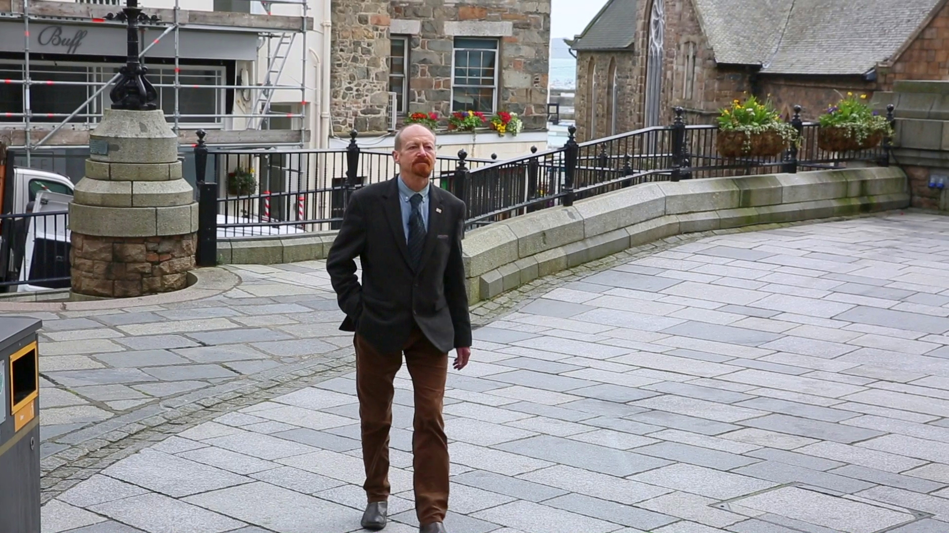Photo of Jonathan Crossan walking in St Peter Port